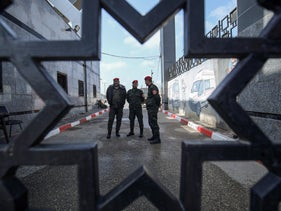 Palestinian security forces loyal to Hamas stand at the Rafah border crossing with Egypt in the southern Gaza Strip, March 15, 2020.