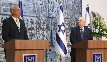 Benny Gantz, left, and President Reuven Rivlin speak at the President's Residence in Jerusalem, March 16, 2020.