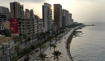 Beirut's waterfront promenade, along the Mediterranean Sea, is mostly empty after municipal policemen ordered people to leave, in Beirut, Lebanon, Sunday, March 15, 2020.