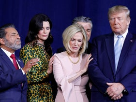 U.S. President Donald Trump participates in a prayer before speaking at an Evangelicals for Trump Coalition Launch at the King Jesus International Ministry in Miami, FL, U.S., January 3, 2020.