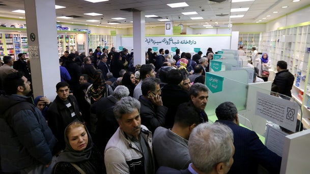 """Iranians wait to get prescription drugs at the state-run """"13 Aban"""" pharmacy in Tehran, February 19, 2020"""