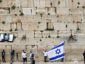 People pray at the nearly deserted Western Wall, after Israel has imposed some of the world's tightest restrictions to contain COVID-19 coronavirus disease, Jerusalem, March 12, 2020.