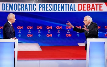 Sen. Bernie Sanders, I-Vt., right, and former Vice President Joe Biden, left, return to the stage after a commercial break in a Democratic presidential primary debate at CNN Studios, March 15, 2020.