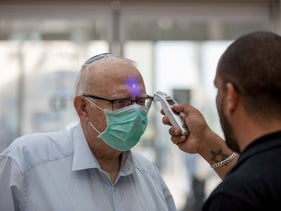 A man being tested for a fever, Hadassah Medical Center, March 12, 2020