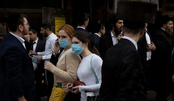 Jewish ultra-Orthodox girls wear face masks during celebrations of the Jewish festival of Purim in Bnei Brak, Israel, March 10, 2020.