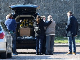 Relatives of a person who died from coronavirus disease (COVID-19) arrive at a cemetery in Bergamo, Italy March 16, 2020.
