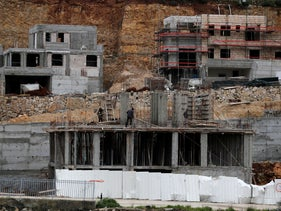 Palestinian Laborers work at a construction site in the Israeli settlement of Ramat Givat Zeev, March 19, 2020