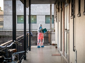 A health official at a residential building in Milan, Italy, March 17, 2020.