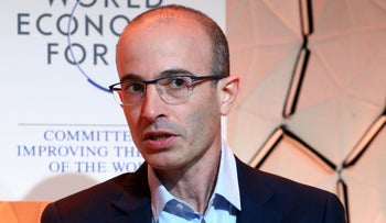 Yuval Noah Harari attends a session at the 50th World Economic Forum (WEF) annual meeting in Davos, Switzerland, January 21, 2020.