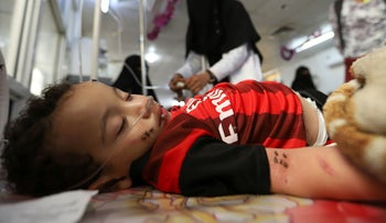A boy lies on a bed as he recuperates from dengue fever at a hospital in Hodeida, Yemen, January 21, 2020.