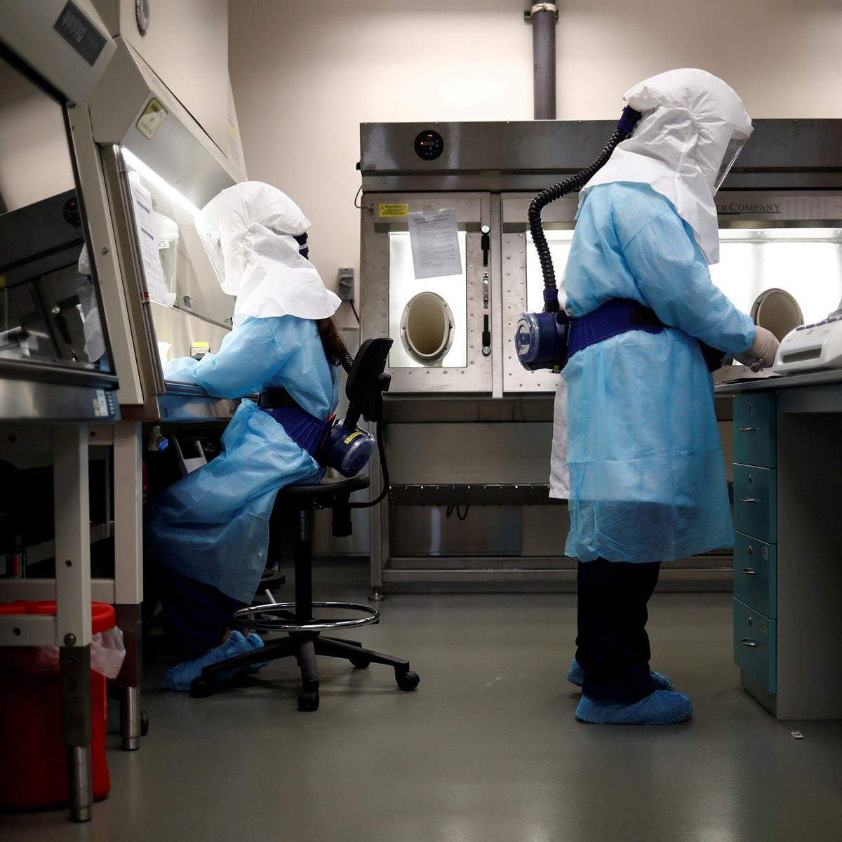 Home Team Science & Technology Agency (HTX) scientists demonstration the test process of their coronavirus test kit at their laboratory in Singapore, March 5, 2020.