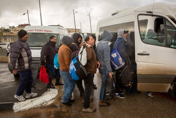 Palestinian workers entering Israel for a two-month stay, March 18, 2020.