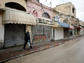 Closed shops in a street in Ashkelon during spread of coronavirus disease, Israel March 20, 2020.