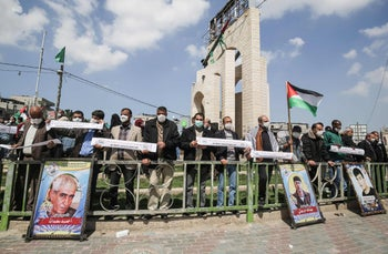 Palestinians at a protest in solidarity with Palestinian prisoners in Israeli jails outside the UN High Commissioner's offices in Rafah Gaza, March 16, 2020.