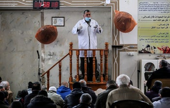 A representative from the Red Crescent health organization speaks at Friday prayer warning about the coronavirus. Rafah,  southern Gaza Strip, March 20, 2020