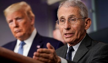 Director of the National Institute of Allergy and Infectious Diseases Anthony Fauci speaks as U.S. President Donald Trump listens during a news briefing on the administration's response to the coronavirus disease (COVID-19) outbreak at the White House in Washington, U.S., March 21, 2020