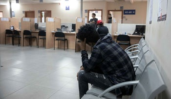 An asylum seeker waits at the Population and Immigration Authority office in Bnei Brak, December 25, 2019.