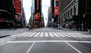 Times Square stands mostly empty as as much of the city is void of cars and pedestrians over fears of spreading the coronavirus on March 22, 2020 in New York City