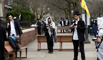 Orthodox Jewish men in Brooklyn practicing social distancing as they pray, March 20, 2020.