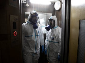 Workers disinfect the elevator at The Great Synagogue, Tel Aviv, March 17, 2020