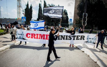 A protest outside the Israeli parliament in Jerusalem against the 'assault on democracy', Thursday, March 19, 2020.