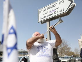 A protester near the Supreme Court in Jerusalem, March 24, 2020