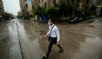 A man wears a protective mask following an outbreak of the coronavirus in downtown of Cairo, Egypt, March 12, 2020.