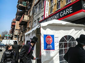 Signs on a tent at the entrance of Chai Urgent Care in Brooklyn's Williamsburg community, March 18, 2020.