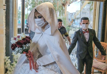 A bride and groom arrive to take wedding pictures, Khan Yunis, Gaza Strip, March 23, 2020.