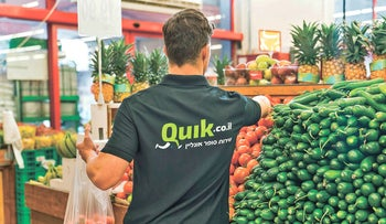 "A delivery employee of the ""Super Quik"" service by the Israeli supermarket startup Quik, on March 23 2020."