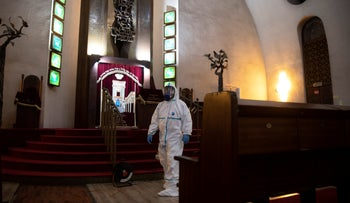 Workers in protective gear disinfect the Great Synagogue, Tel Aviv, March 17, 2020