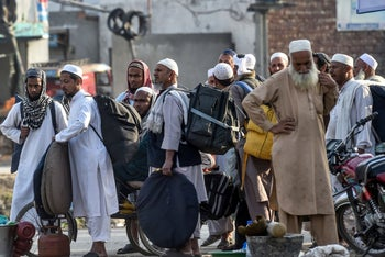 Tablighi Jamaat followers journey home from the three-day annual Ijtema religious gathering, mid concerns the 250,000 strong event would spread the coronavirus. Raiwind near Lahore, March 13, 2020