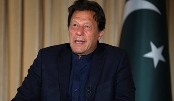Pakistan's Prime Minister Imran Khan speaks to the AP, in Islamabad, Pakistan. March 16, 2020. Khan called for an end to sanctions on Iran which, he said, hampered Tehran's anti-coronavirus efforts