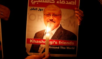 A demonstrator holds a poster with a picture of Saudi journalist Jamal Khashoggi outside the Saudi Arabia consulate in Istanbul, Turkey October 25, 2018