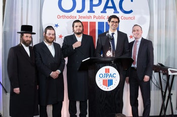 Aron Spielman, second from left, a co-founder of the Orthodox Jewish Public Affairs Council.