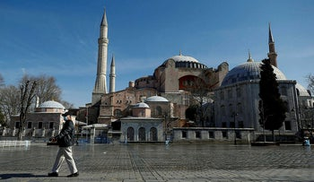 A face-masked man walks past Haghia Sophia Museum amid the coronavirus outbreak, in Istanbul, March 21, 2020.
