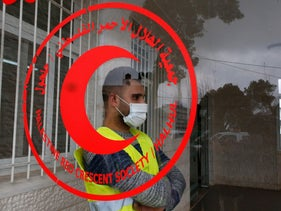 A paramedic of the Red Crescent Society wearing a protective face mask near Hebron in mid-March.