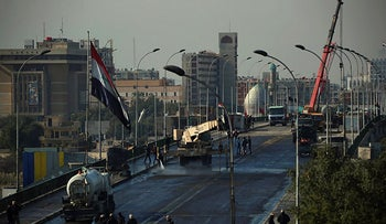 Iraqi security forces removed concrete walls in preparation to re-open Sinak Bridge, leading to the heavily fortified Green Zone which houses the seat of the country's government and foreign embassies