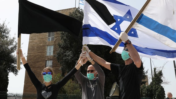 Protesters against 'weakening Israel's democracy' near the Knesset in Jerusalem, March 23 2020