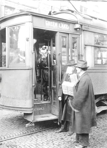 A street car conductor in Seattle in 1918 refusing to allow passengers aboard who are not wearing masks.