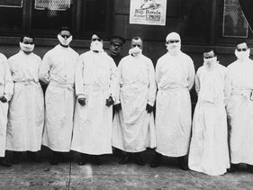 Doctors, army officers, and reporters tour a hospital to observe Spanish influenza treatment of patients.