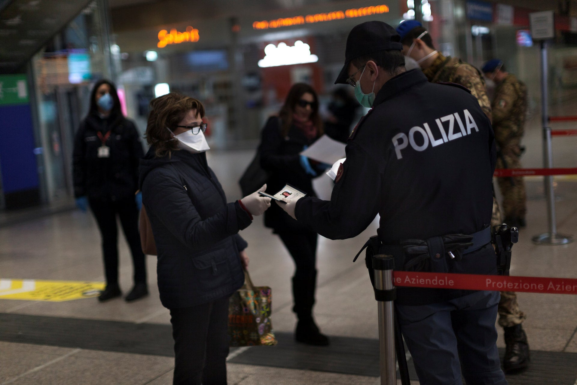 Italian police check people's documents.