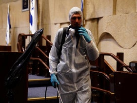 An emergency worker disinfects the Knesset during the coronavirus outbreak, March 15, 2020.
