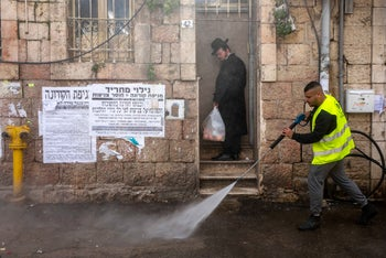 A sanitation worker and resident in the Mea Shearim neighborhood in Jerusalem, March 28, 2020.