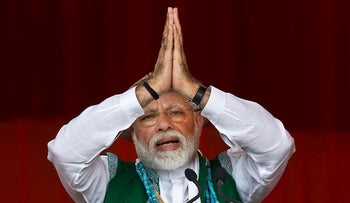 In this March 30, 2019 file photo, Indian Prime Minister Narendra Modi gestures as he speaks during an election campaign rally of his Bharatiya Janata Party (BJP) in Along, Arunachal Pradesh, India