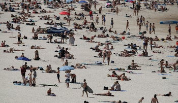 Beachgoers enjoy a sunny day at Bondi Beach despite growing concerns about the spread of the coronavirus in Sydney, Australia, on March 20.