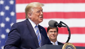 U.S. President Donald Trump speaks near U.S. Defense Secretary Mark Esper during a send off for the Navy hospital ship USNS Comfort at Naval Station Norfolk, Virginia, U.S. March 28, 2020.