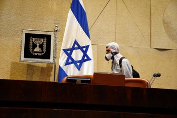 Disinfecting the Knesset chamber.