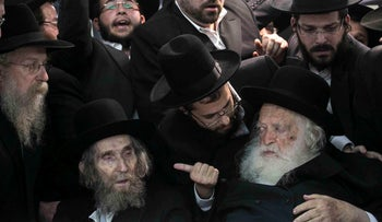 Rabbi Chaim Kanievsky, right, and some of his followers in Jerusalem, 2013.