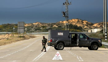 An Israeli soldier and armored vehicle block a road, February 24, 2020.
